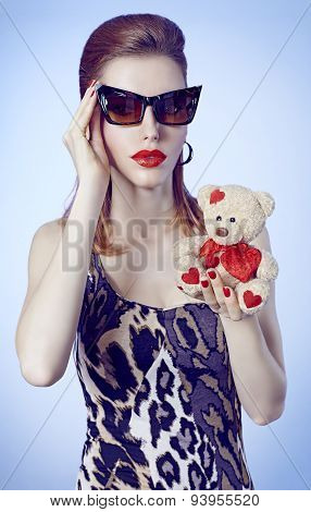 Portrait Fashion girl in glasses, Loving teddy bear with hearts