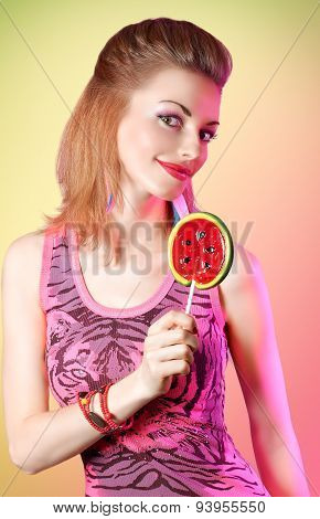 Portrait of mischievous redhead girl with big lollipop. Fashion dressed