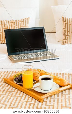 Laptop And Breakfast Tray In Bed Hotel