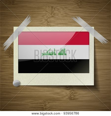 Flags Iraq At Frame On Wooden Texture. Vector