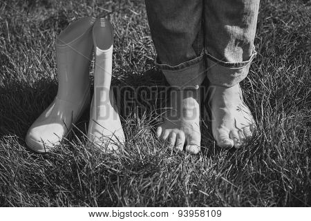 Black And White Shot Of Girl Took Off Boots And Standing On Grass