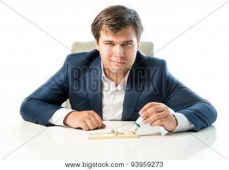 Cunning Businessman Putting Money In Trap As Lure