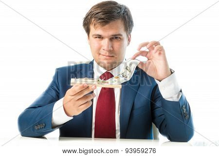 Cunning Businessman Taking Dollar Bill Out Of Mousetrap