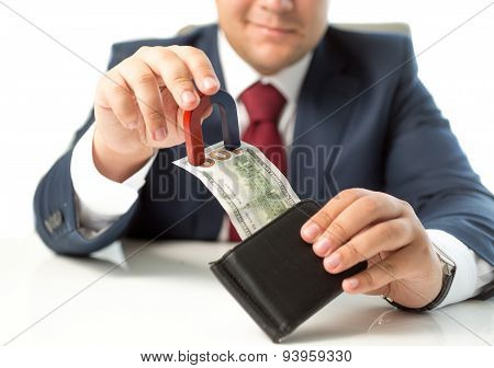 Closeup Of Businessman Stealing Money From Wallet With Magnet