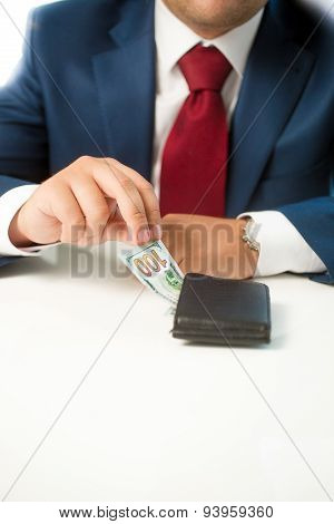 Closeup Of Businessman Stealing Money From The Wallet