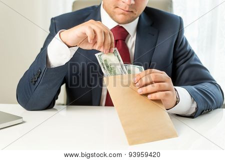 Conceptual Shot Of Bribed Politician Taking Envelope With Money
