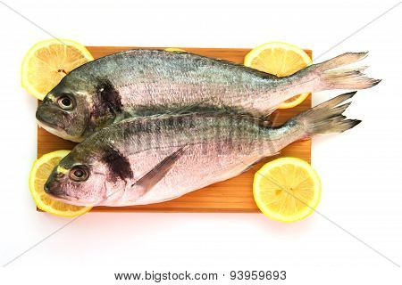 Two Dorado On Wooden Board