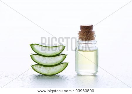Fresh Aloe Vera With Aroma Oil On Moisture Background