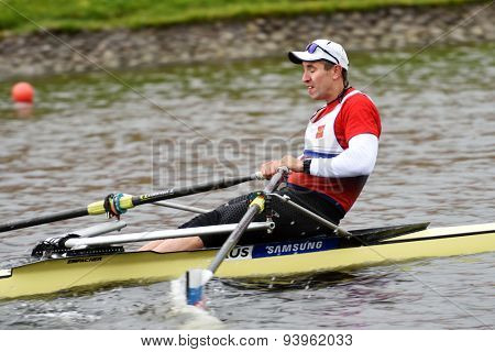 ST. PETERSBURG, RUSSIA - JUNE 12, 2015: Denis Kleshnev in semifinal of rowing competitions on single scull during the Golden Blades Regatta. It is is one of the best known regatta in Russia
