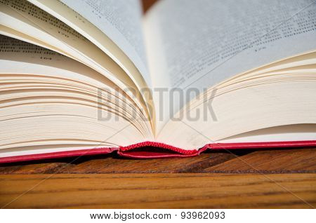 Red book on a wooden chair