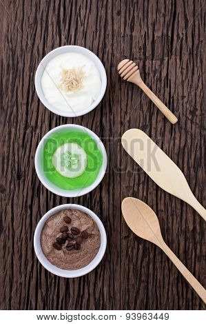 Homemade Body Scrubs On Wood Background