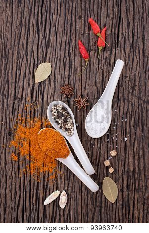 Collection Of Spicy Ingredients On Wooden Background