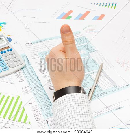 Male Showing Thumb Up Over Us 1040 Tax Form - Focus On Calculator