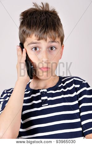 Young boy talking on his smart phone