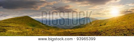 Panorama Of Hillside With Stones In High Mountains At Sunset