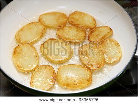 Frying Potatoes.