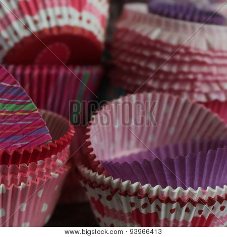 Background full of pink, red and purple cupcake papers