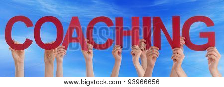 Hands Holding Red Straight Word Coaching Blue Sky