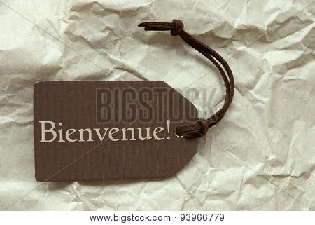 Brown Label With French Bienvenue Means Welcome