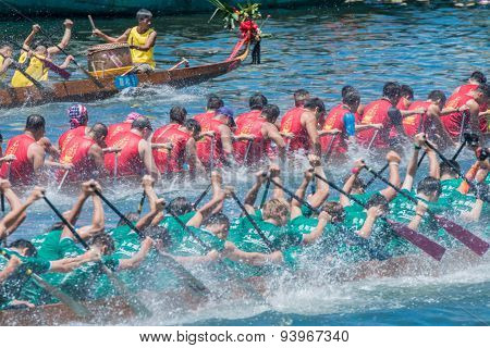 ABERDEEN,HONGKONG,JUNE 20 2015: Boats racing in the Love River for the Dragon Boat Festival