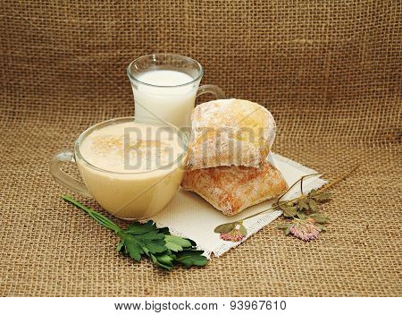 Milk, Fermented Baked Milk With Foam, Bread, Parsley And Dried Clover.