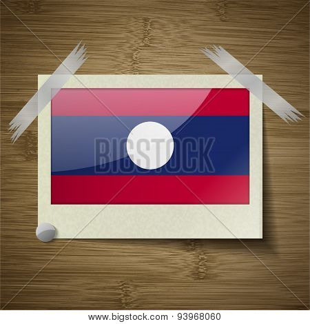 Flags Laos At Frame On Wooden Texture. Vector