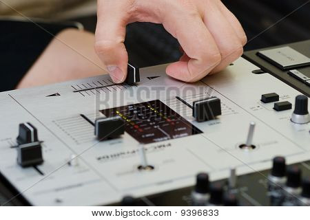 Hand Of A Dj Adjusting The Crossfader