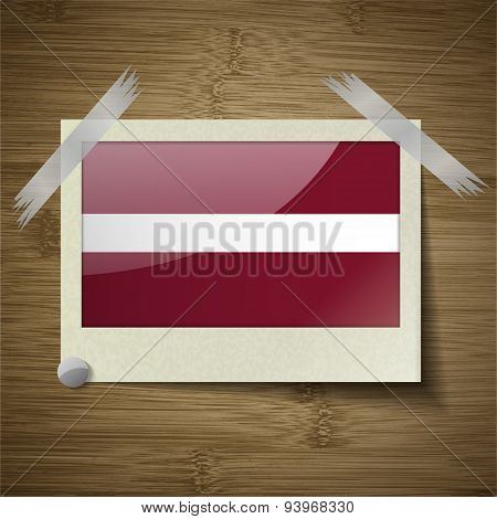 Flags Latvia At Frame On Wooden Texture. Vector