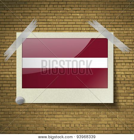 Flags Latvia At Frame On A Brick Background. Vector