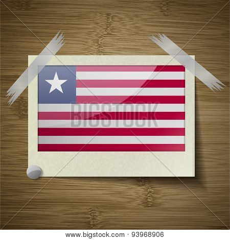 Flags Liberia At Frame On Wooden Texture. Vector