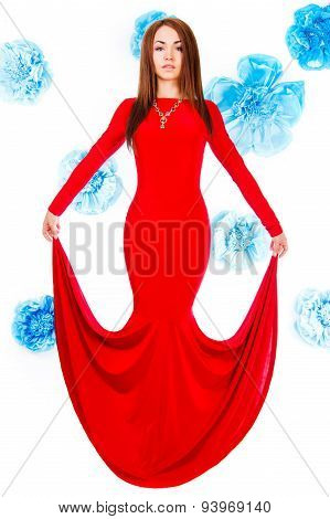 Beautiful Young Woman In A Long Red Evening Dress