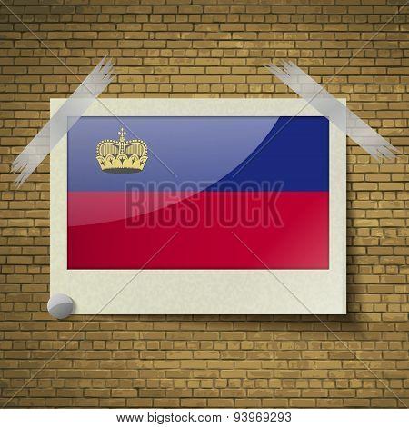 Flags Liechtenstein At Frame On A Brick Background. Vector