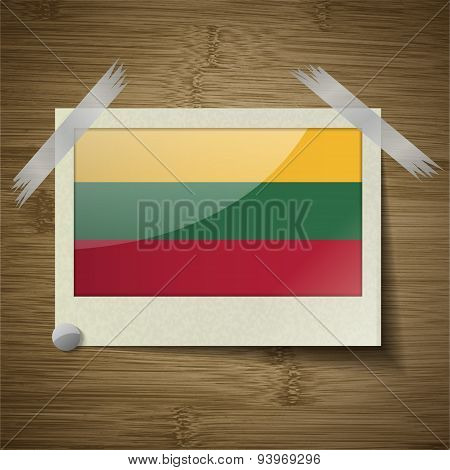 Flags Lithuania At Frame On Wooden Texture. Vector