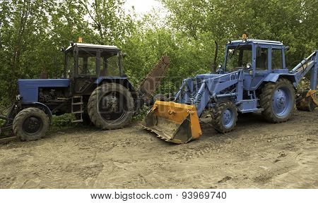 two blue tractors