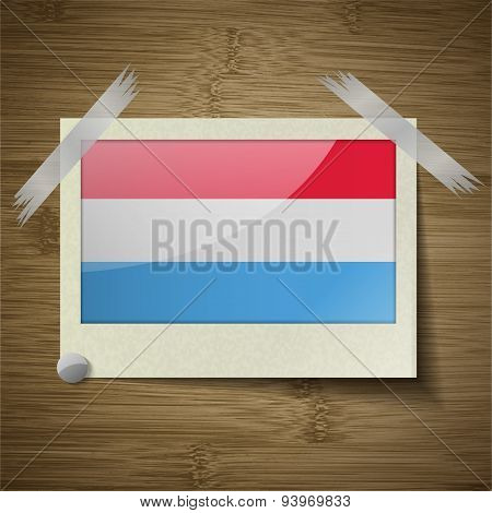 Flags Luxembourg At Frame On Wooden Texture. Vector