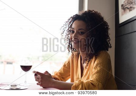 Woman With Smartphone In Restaurant
