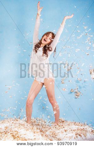 Beautiful Young Woman In A Bed Dropping The Feathers