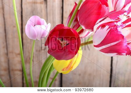 Bouquet Of Red Tulips Against A Wooden Background, Close Up Flowers