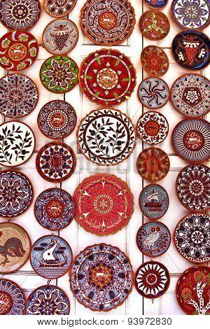 Brightly coloured mediterranean ceramic plates display.