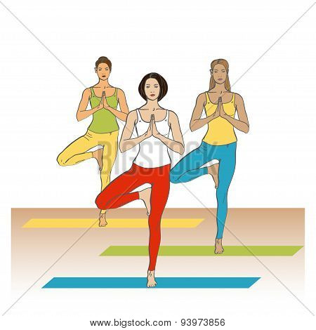 Women in yoga poses in yoga class.