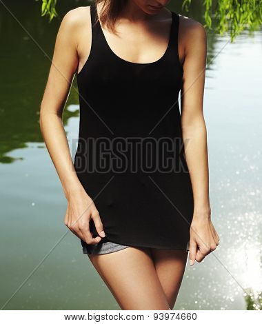 Woman wearing black tshirt in the city park