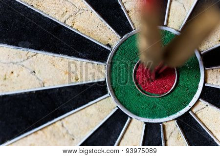 Dartboard With Steeldarts In Bullseye