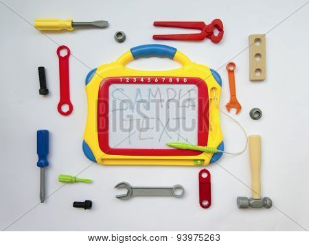 Background With Toys, Locksmith Tools, Board Letters, Top View
