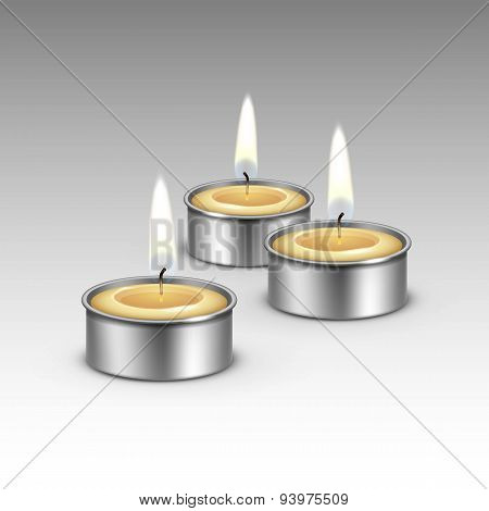 Candles in the Metal Candlesticks