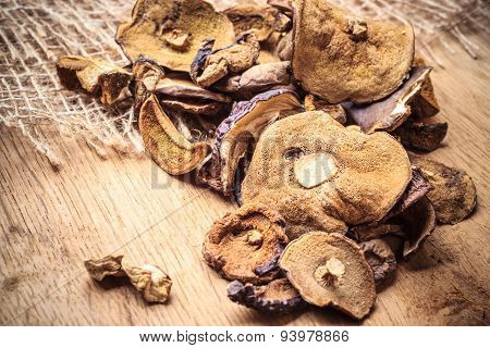Dry Mushrooms On Wooden Rustic Table.