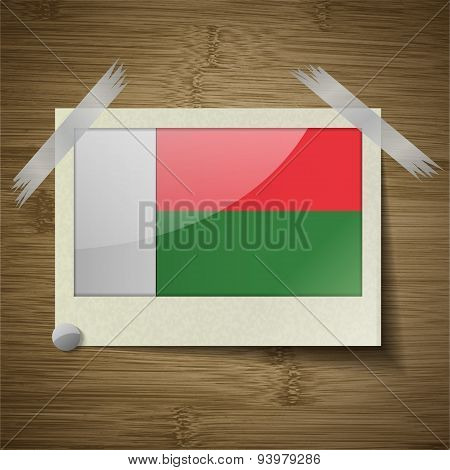 Flags Madagascar At Frame On Wooden Texture. Vector