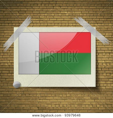 Flags Madagascar At Frame On A Brick Background. Vector