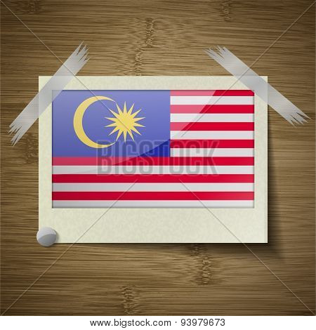 Flags Malaysia At Frame On Wooden Texture. Vector