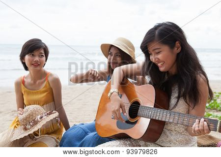 Portrait Group Of Young Asian Woman Palying Guitar In Sea Beach Picnic Party At Sea Side With Happin