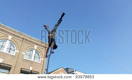 performer doing aerial handstand